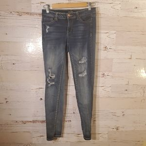 Wax distressed skinny jeans